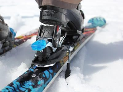 Ski and boot on the snow